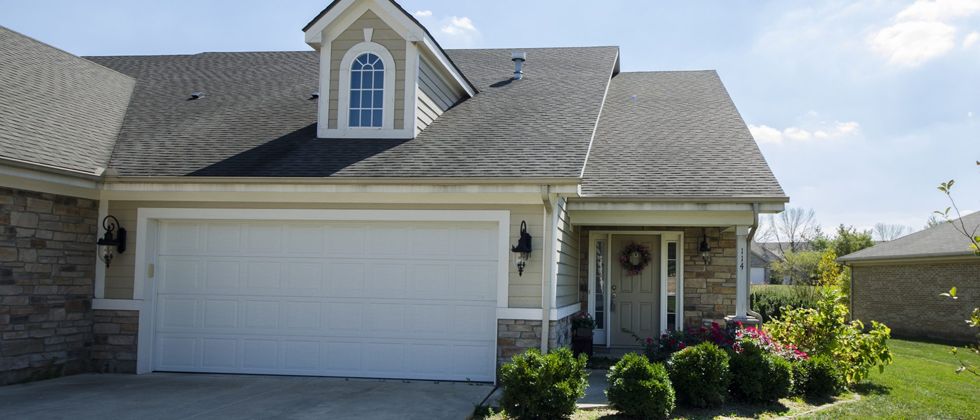 Exterior of a custom duplex in Fairway Crossing. Leased by Design Homes and Development.