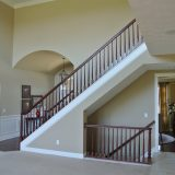 Custom stairwell of 1601 Wisteria by Design Homes & Development.