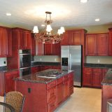 Custom kitchen of 1601 Wisteria by Design Homes & Development.