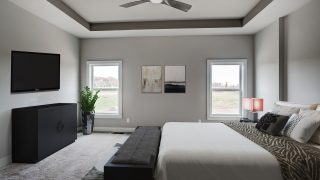 Master Bedroom of the Jocelyn II in Bridle Creek Ranch by Design Homes.