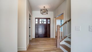 The entry of the Sierra II in Cypress Ridge by Design Homes