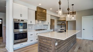 The kitchen of the Sierra II in Cypress Ridge by Design Homes