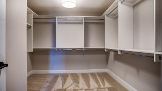 The master closet of the Sierra II in Cypress Ridge by Design Homes