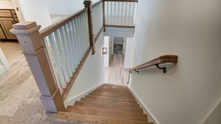 The stairs of the Sierra II in Cypress Ridge by Design Homes