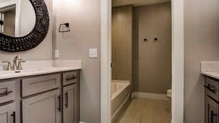 A bath of the Sierra II in Cypress Ridge by Design Homes