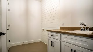The laundry room of the Sierra II in Cypress Ridge by Design Homes
