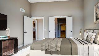 The master bedroom of the Sierra II in Cypress Ridge by Design Homes