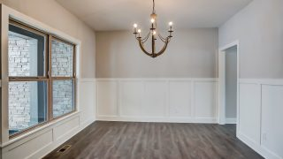 The dining room of the Triple Crown in Savannah Farms by Design Homes