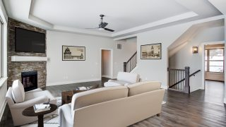 The great room of the Triple Crown in Savannah Farms by Design Homes