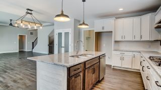 The kitchen of the Triple Crown in Savannah Farms by Design Homes