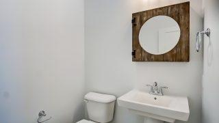 A bathroom of the Triple Crown in Savannah Farms by Design Homes