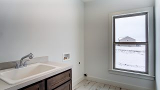 The laundry room of the Triple Crown in Savannah Farms by Design Homes