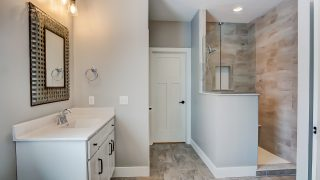The master bath of the Triple Crown in Savannah Farms by Design Homes