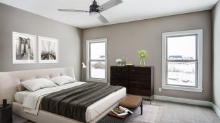 The master bedroom of the Triple Crown in Savannah Farms by Design Homes