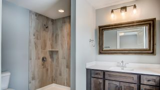 A bathroom of the Triple Crown in Savannah Farms by Design Homes