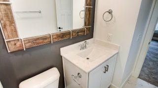 A Bathroom of the Oakwood in Soraya Farms by Design Homes
