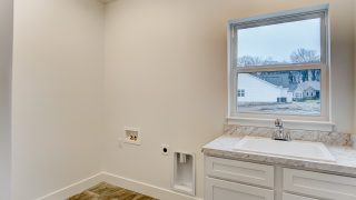 The Laundry Room of the Oakwood in Soraya Farms by Design Homes