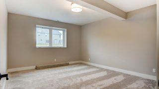 A Bedroom of the Oakwood in Soraya Farms by Design Homes