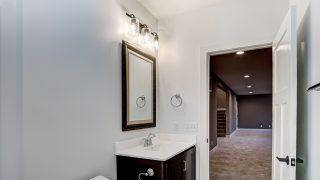 A Bathroom of the Oakwood in Soraya Farms by Design Homes