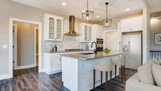 The Kitchen of the Brooklyn in Bridle Creek Ranch by Design Homes