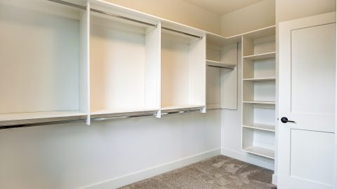 The Master Closet of the Anna in Cypress Ridge by Design Homes