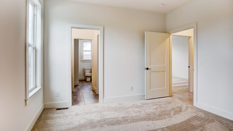 A Bedroom of the Anna in Cypress Ridge by Design Homes