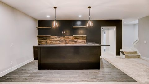 The Rec Room of the Anna in Cypress Ridge by Design Homes