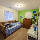 Bedroom of 2406 Brown Bark by Design Homes custom home builder.