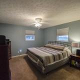 Master bedroom of 2406 Brown Bark by Design Homes custom home builder.