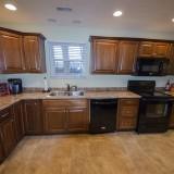Kitchen of 2406 Brown Bark by Design Homes custom home builder.