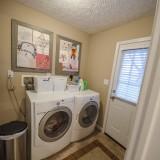 Laundry room of 2406 Brown Bark by Design Homes custom home builder.