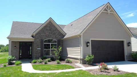 Custom exterior of a home located in Soraya Farms. Built by Design Homes and Development.