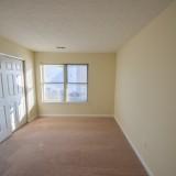 Upstairs bedroom in Fairway Crossing rental, by Design Homes.