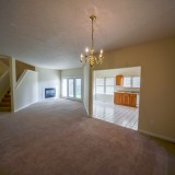 Living room and dining in Fairway Crossing rental by Design Homes.