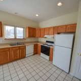 Kitchen with pantry in Fairway Crossing rental by Design Homes.