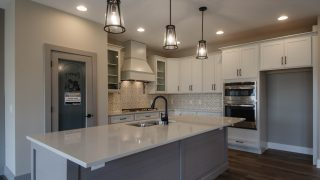 Kitchen of the Riverwood in Savannah Farms by Design Homes