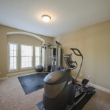 Custom exercise room by Design Homes.