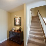 Custom stairwell by Design Homes.