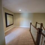 Custom second story loft area by Design Homes.