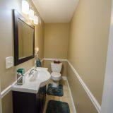 Design Homes, custom builder, outside listing half bathroom.