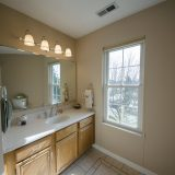 Bathroom of Beach residence. Listed by Design Homes & Development.