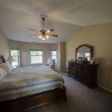 Bedroom of Beach residence. Listed by Design Homes & Development.