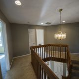 Stairwell of Beach residence. Listed by Design Homes & Development.