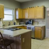 Kitchen of Beach residence. Listed by Design Homes & Development.