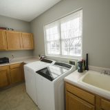 Laundry room of Beach residence. Listed by Design Homes & Development.