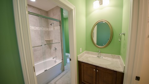 Jack-and-Jill bathroom by Design Homes. Located in Bridle Creek Ranch.