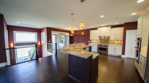 Custom kitchen with walk-out. Built by Design Homes, Dayton home builder.