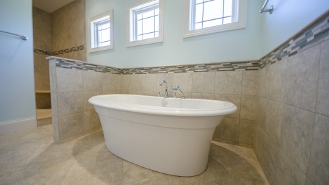 Custom master bathroom with free standing bathtub. Built by Design Homes.