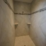 Custom walk-in shower by Design Homes.