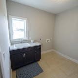 Custom laundry room by Design Homes.